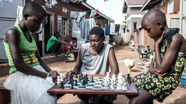 Lillian Asaba takes her opponent's Queen during a session at the Katwe Chess Academy [Aurelie Marrier d'Unienville/Al Jazeera]