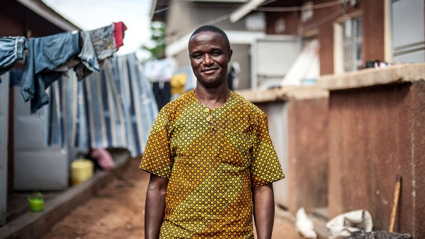 Robert Katende, photographed outside the chess academy in Katwe, one of the largest slums in the Ugandan capital [Aurelie Marrier d'Unienville/Al Jazeera]