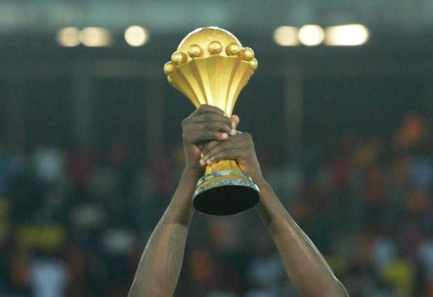 hand holding AFCON trophy