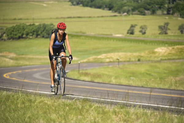 A Woman- Rider, A bicycle, A rural road
