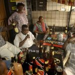 african men drinking alcohol